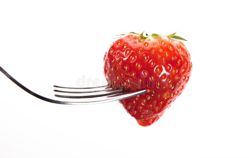 Straberry on a fork stock photo
