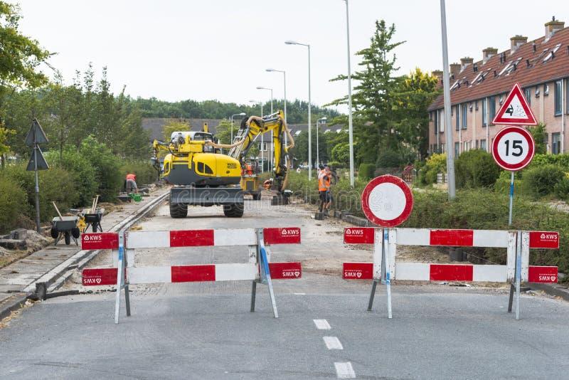 Strada bloccata dai muratori fotografie stock