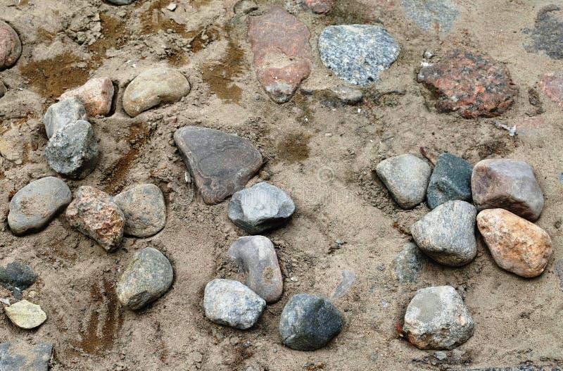 Strada d'annata della pavimentazione della pietra grigia e marrone retro fotografia stock libera da diritti