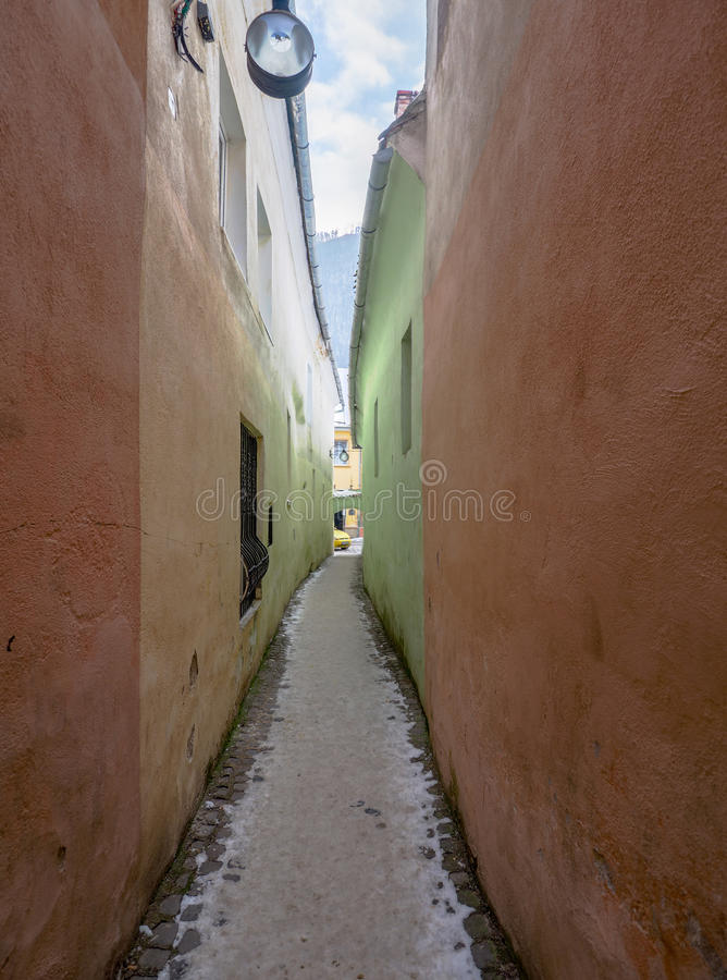 Strada Sforii. Rope Street is the narrowest street in Brasov, Romania, and one of the narrowest in the whole Europe, with a width between 111 and 135 royalty free stock photos