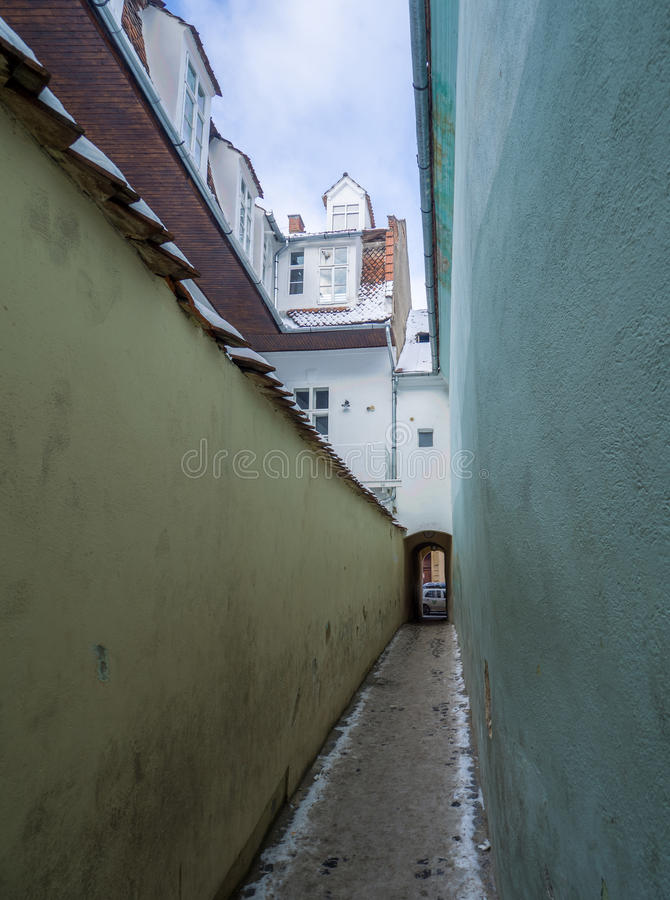 Strada Sforii. Rope Street is the narrowest street in Brasov, Romania, and one of the narrowest in the whole Europe, with a width between 111 and 135 stock images