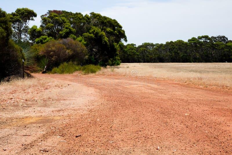 Strada sterrata rossa australiana fotografia stock