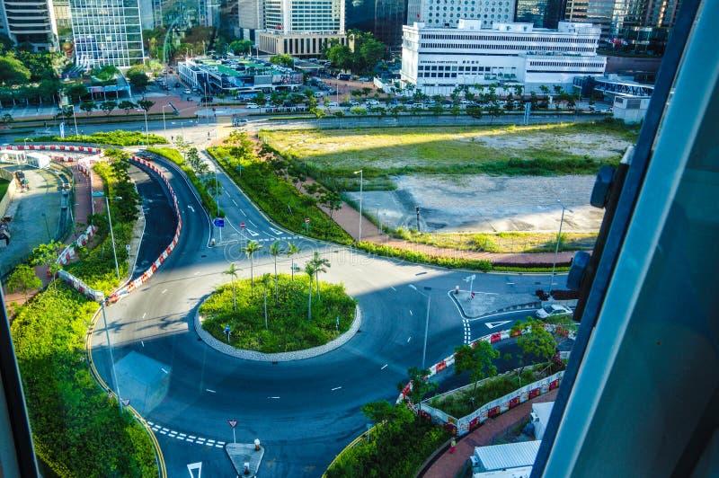 Strade vicino alla ruota di osservazione di Hong Kong immagini stock libere da diritti