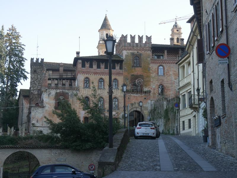 Stradivari Palace in Castell`Arquato. Stradivari Palace with its arch serves as a gateway to the city and has a Tower surmounted by Ghibellines battlements stock photography