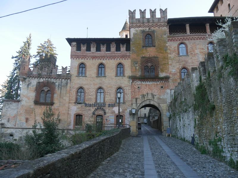 Stradivari Palace in Castell`Arquato. Stradivari Palace with its arch serves as a gateway to the city and has a Tower surmounted by Ghibellines battlements royalty free stock image