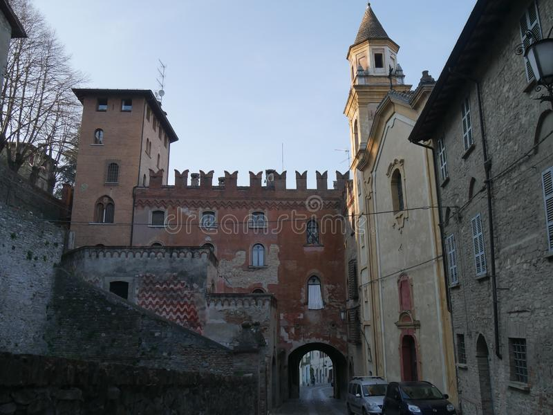 Stradivari Palace in Castell`Arquato. Stradivari Palace with its arch serves as a gateway to the city and has a Tower surmounted by Ghibellines battlements stock photo