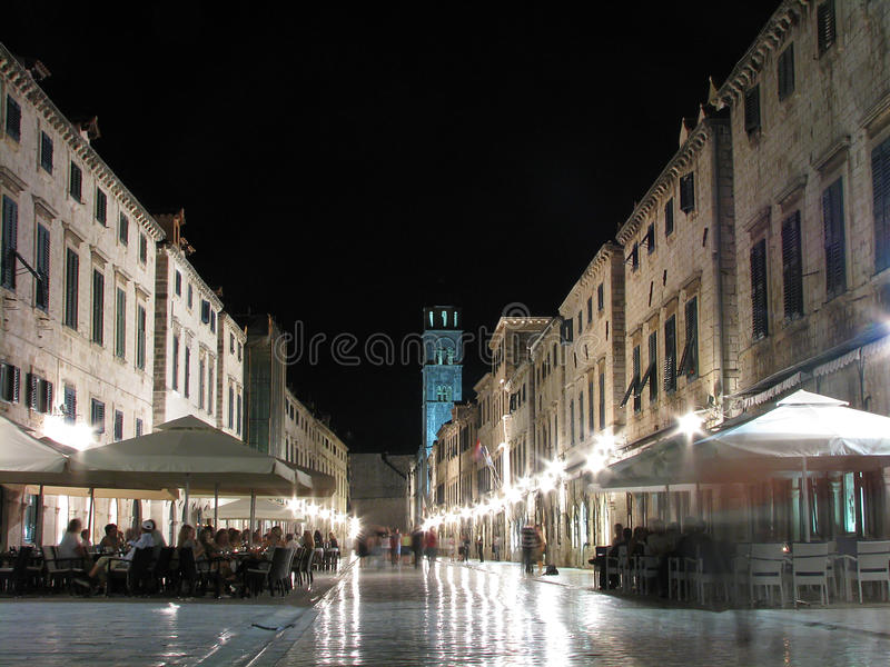 Stradun By Night, Dubrovnik, Croatia. Night view of medieval Dubrovnik main street Stradun with stone pavement and colorful lights stock photo