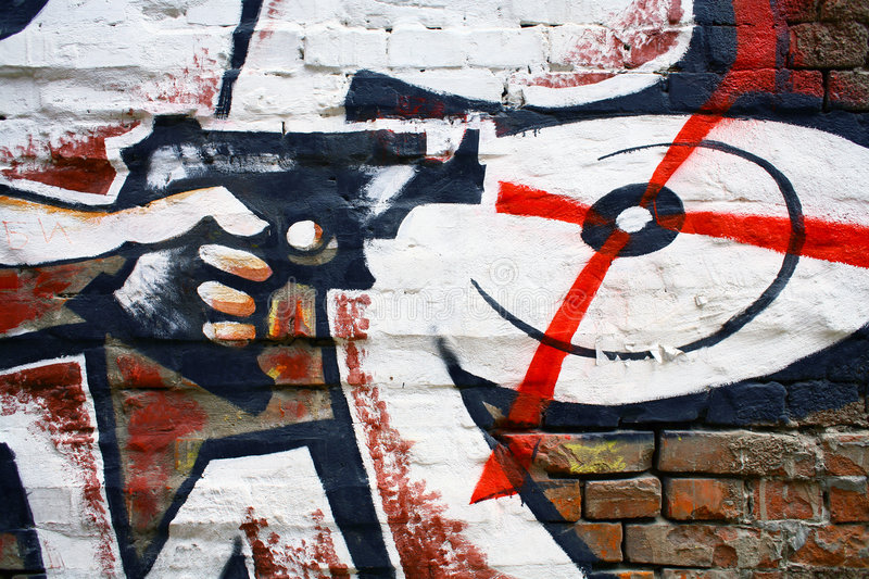 Straight in aim. Graffiti on a wall ideal for urban or grunge background stock images