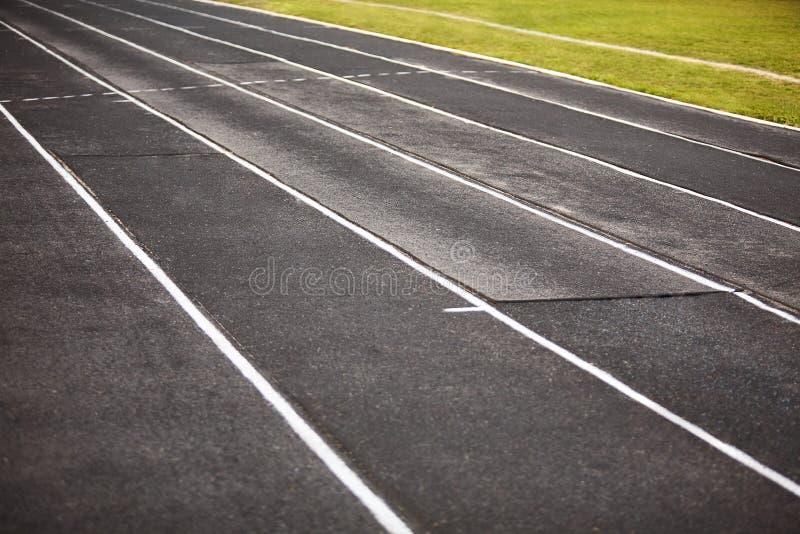Straight black Running Track  on the athletics stadium. royalty free stock image