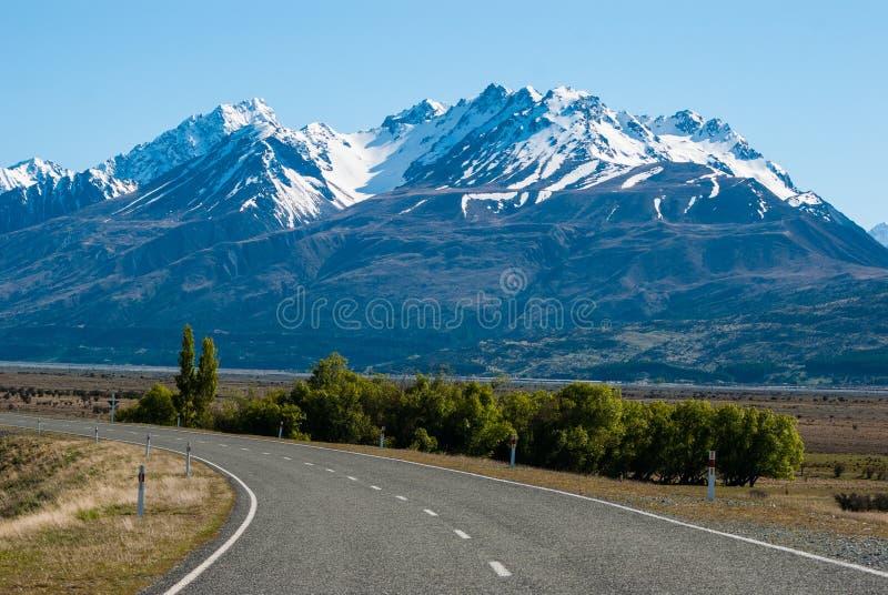 Straight empty road to Mount stock photo