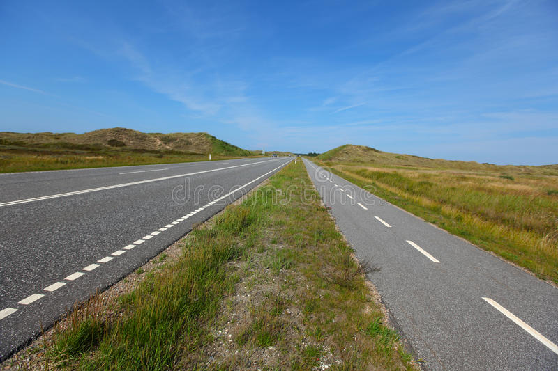 Download Straight, Flat Road Landscape With A Bicycle Lane Stock Image - Image: 21102791