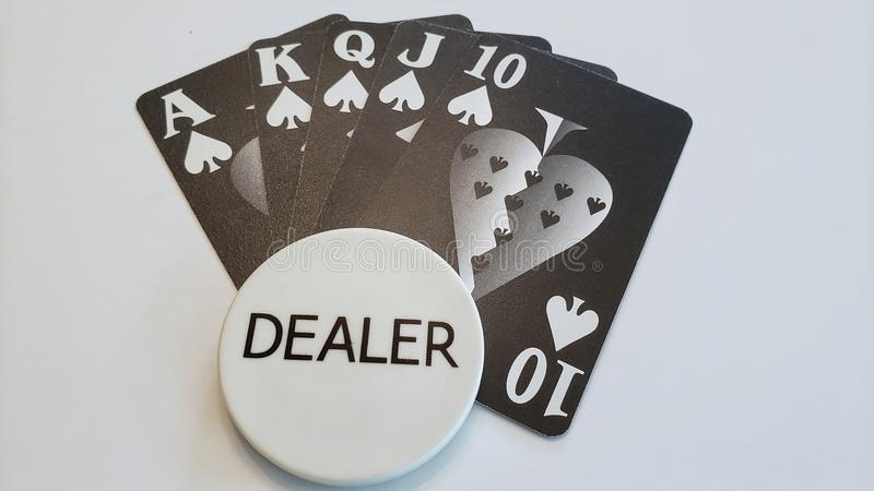 A straight flush poker hand with dealer button. Playing cards showing a straight flush with a dealer button on white background. Gambling and entertainment stock photos