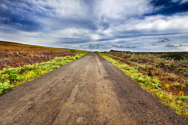 Straight gravel road in Easter Island royalty free stock images
