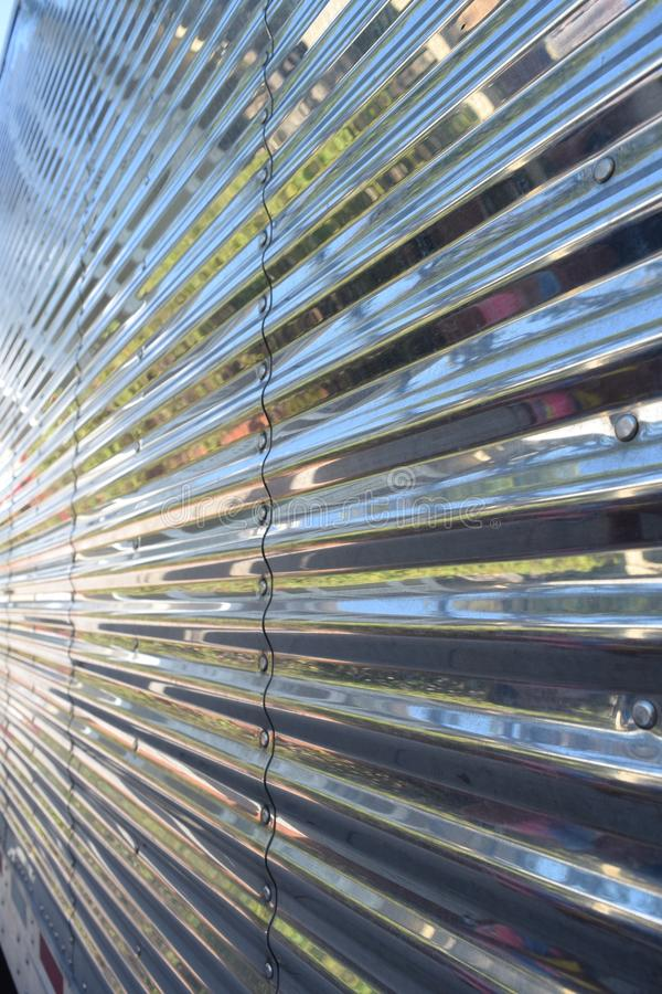 Straight, light flooded parallel lines on the auto body of an american truck. With sunlight from the side royalty free stock photo