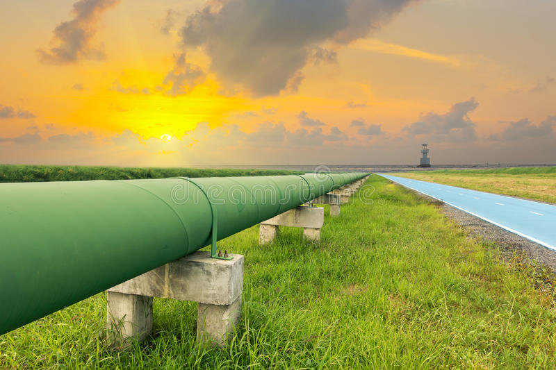 Straight line of potable water pipe on sunrise, Water pipeline. Straight line of potable water pipe on sunrise stock image