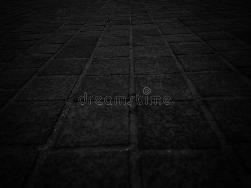 Straight lines and squares of the tile surface for a black background. Straight lines and squares of the tile surface for a black background stock photos
