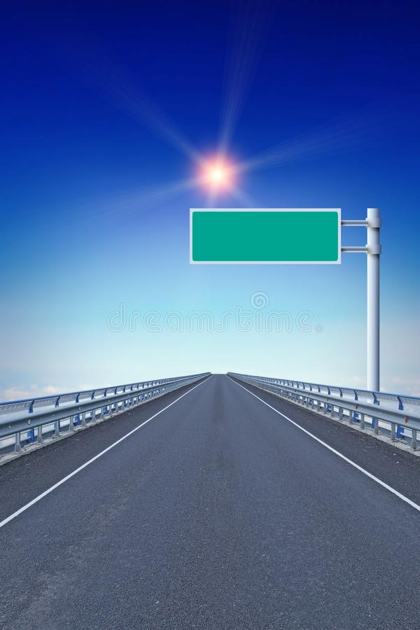 Straight motorway with an empty road sign. Guiding star royalty free stock images