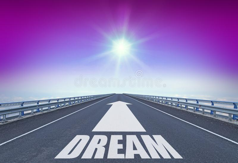 Straight motorway with a forward arrow and text Dream stock image