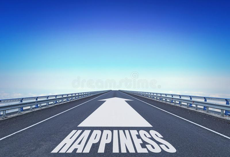 Straight motorway with a forward arrow and text Happiness stock photography