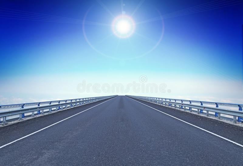 Straight motorway with a guiding star over horizon stock photo