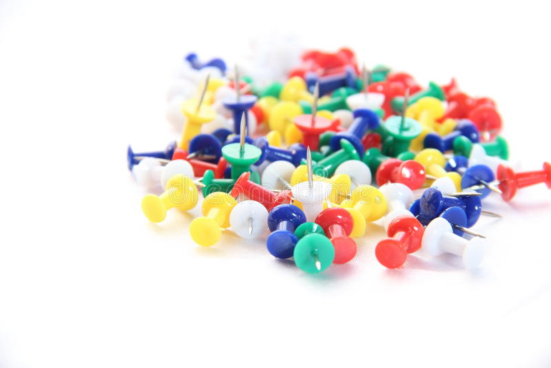 Straight pins on white