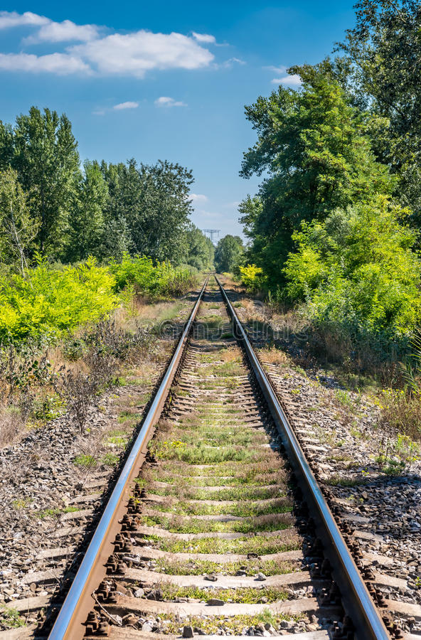 Straight railroad track on Slovak countryside, late summer royalty free stock photography