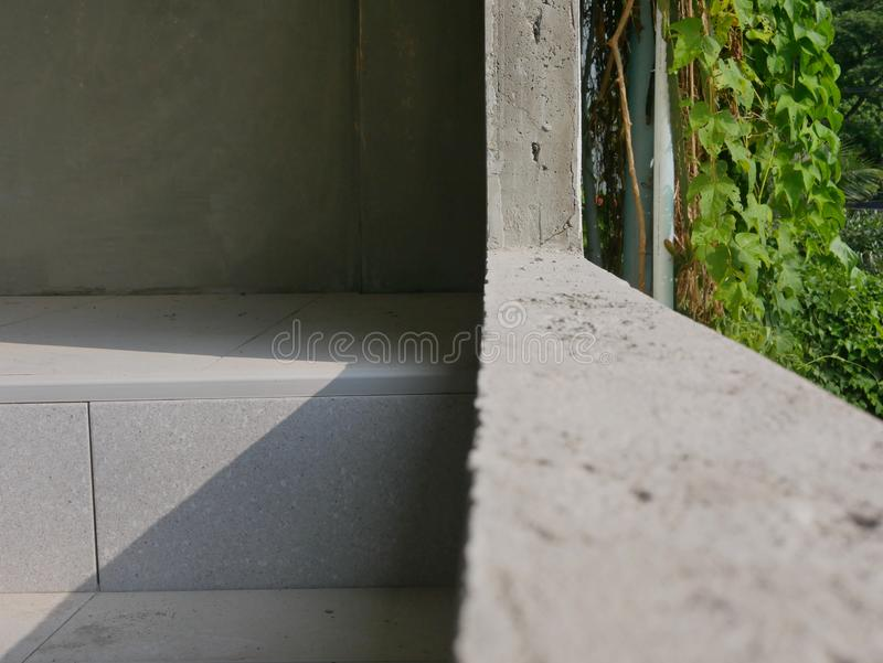 Straight rendered-by-hand dry concrete wall shown after an old window removal, ready for a new window installation royalty free stock image