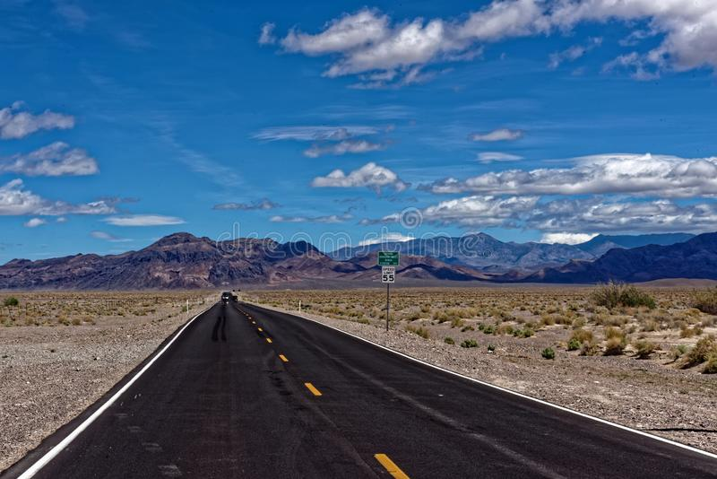 Straight road through Death Valley. A straight road through Death Valley, California stock images
