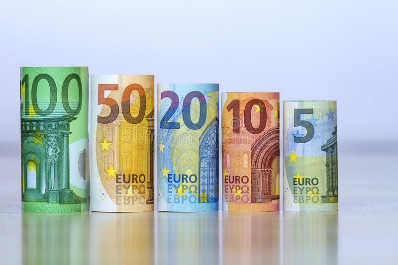 Straight row of accurately rolled hundred, fifty, twenty, ten an. D five new paper euro banknotes isolated on white background. Symbol of financial prosperity royalty free stock image