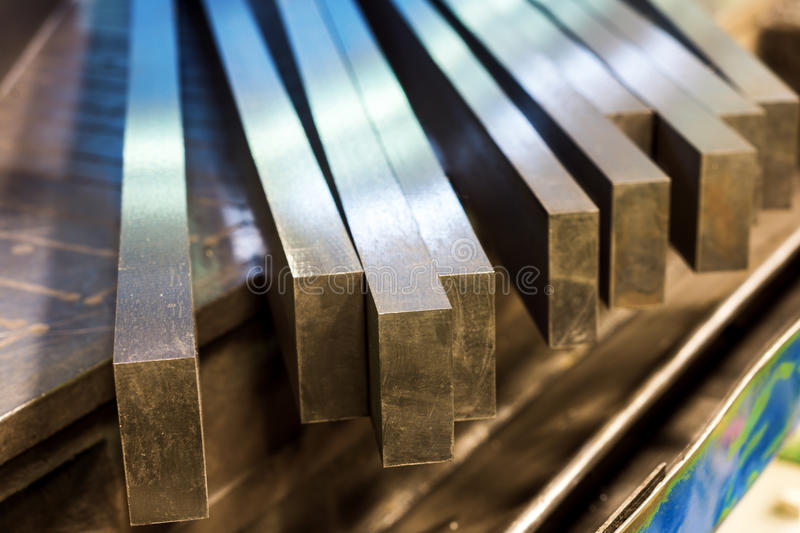 Straight row of metal bars after grinding. Metalworking royalty free stock image