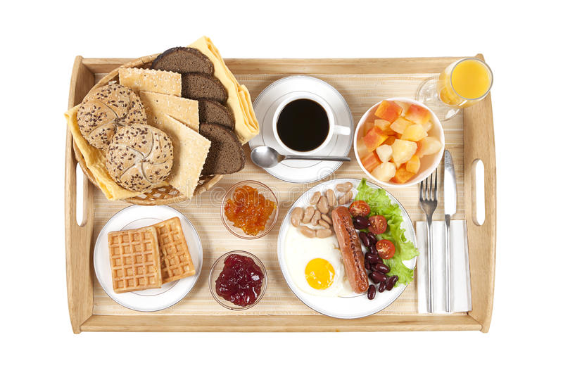 Straight shot of breakfast tray. Straight shot of a typical breakfast tray consisting fried egg with sausage, coffee, jam and bread stock image