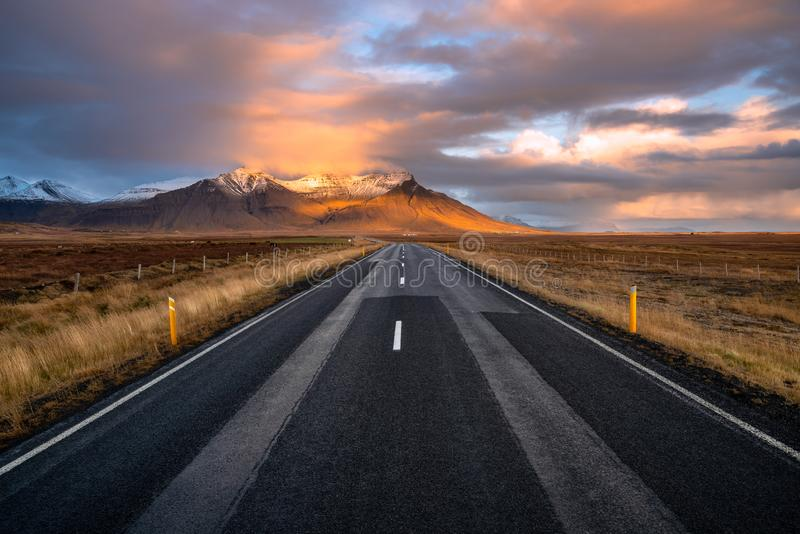 Straight Stretch of a Scenic Road in Iceland at Sunset stock image