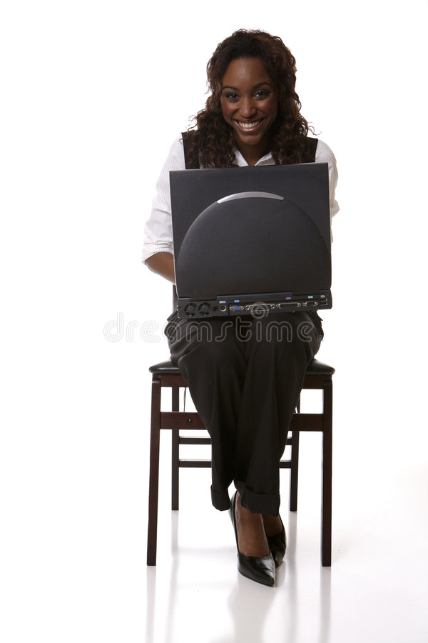 Straight on typing smiling stock photography