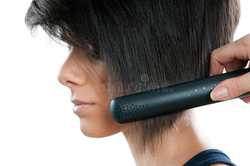 Straightening hair royalty free stock images