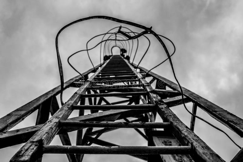 Strairway to heaven. Old trash metal ladder to the sky Black and white stock images