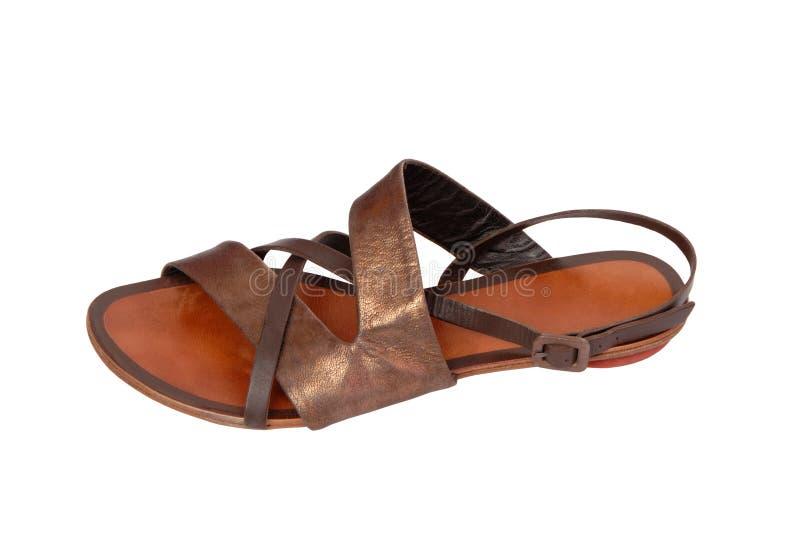 Strand bronzierter zehenfreier Schuh stockbild
