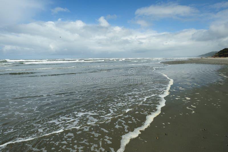 Strand en hemel stock foto's