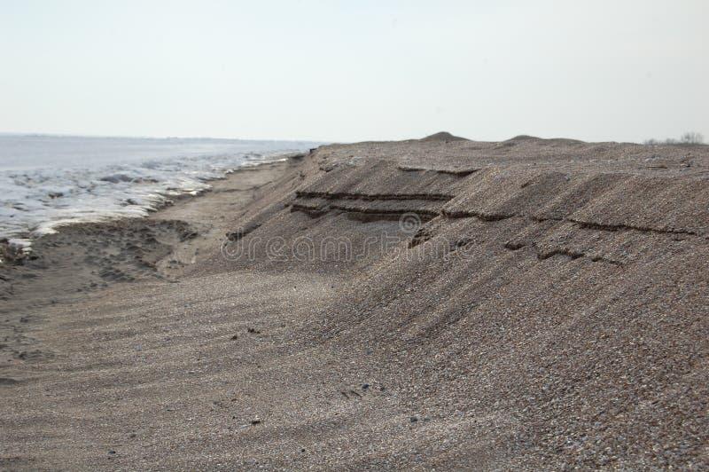 Strand im Winter lizenzfreie stockfotografie