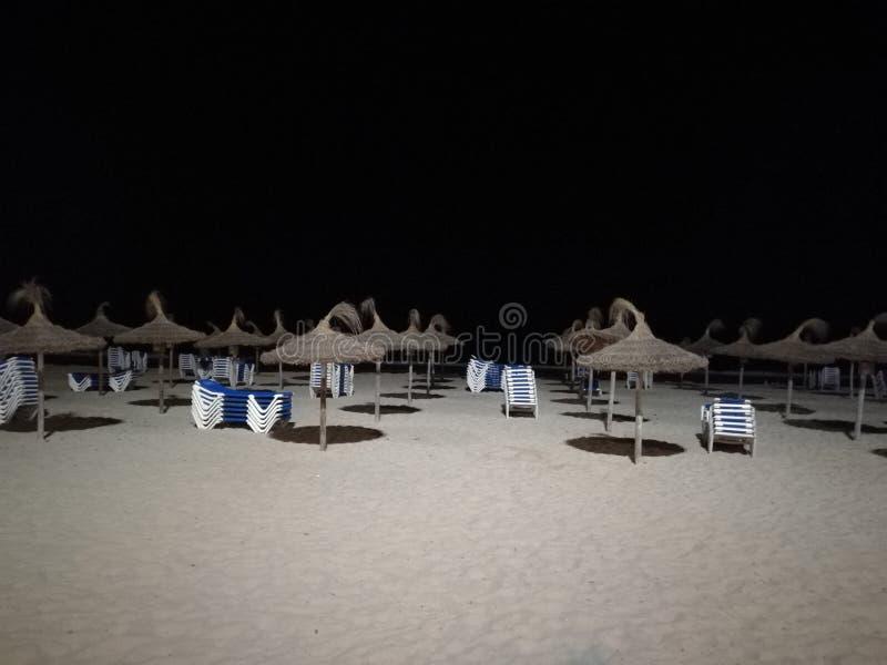 Strand nachts lizenzfreies stockfoto