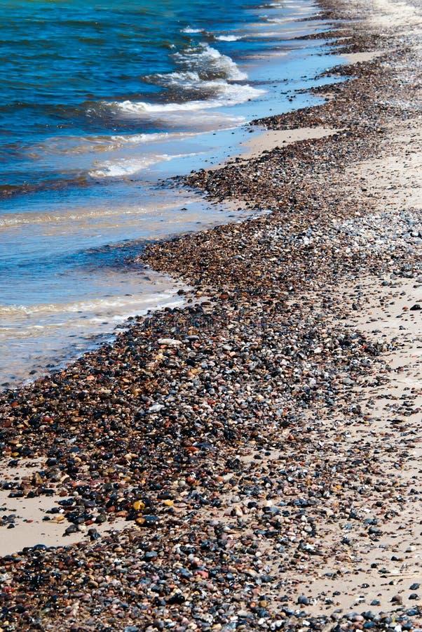 Strand van kiezelsteenstenen royalty-vrije stock afbeeldingen