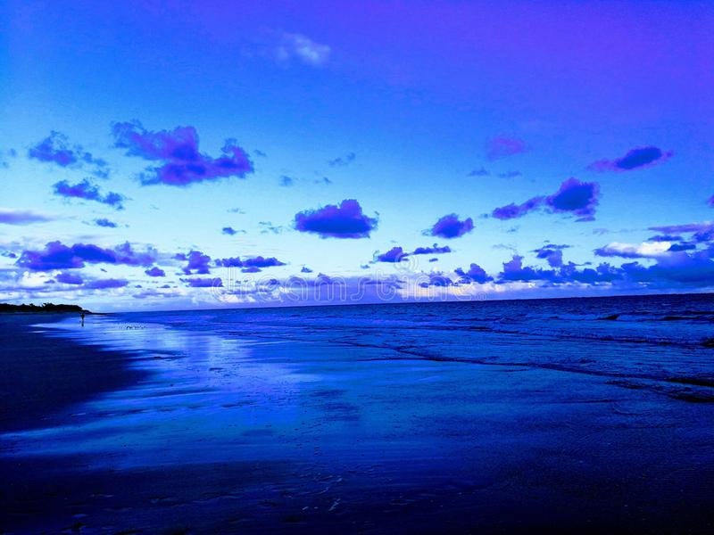 Strand vid natt arkivfoto