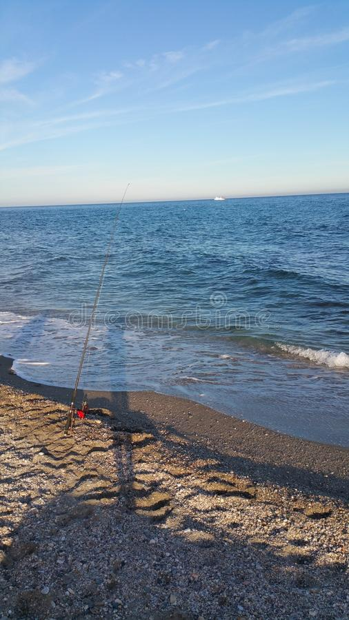 Strand visserij stock afbeeldingen