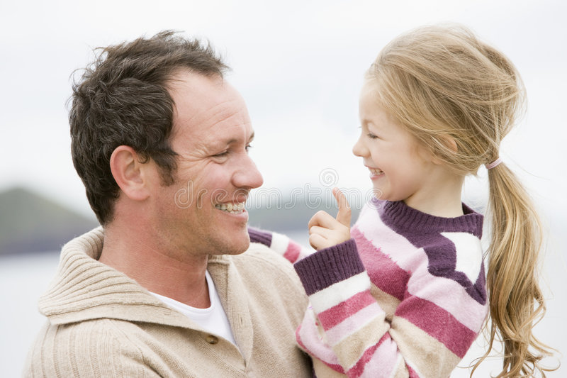 stranddotterfader royaltyfria bilder