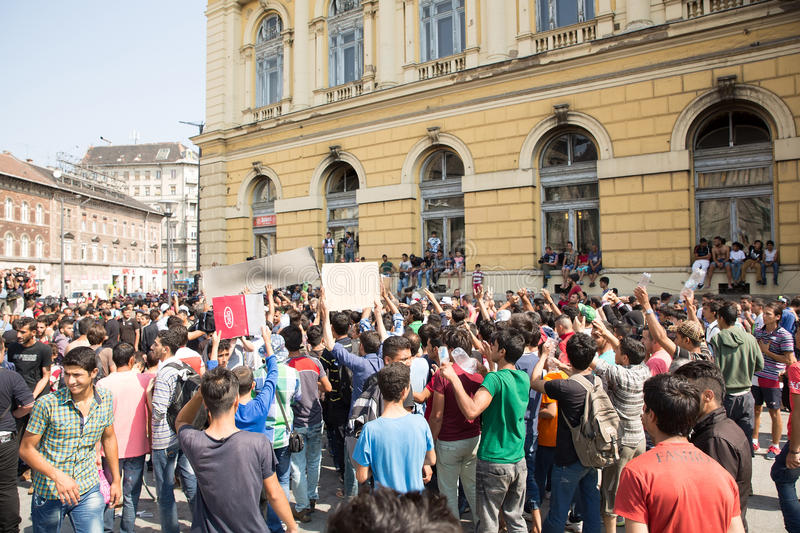 Stranded Refugees protest in front of the Keleti Train station d. BUDAPEST, HUNGARY - SEPTEMBER 01: Stranded Refugees protest and demand free passage to Germany royalty free stock photo