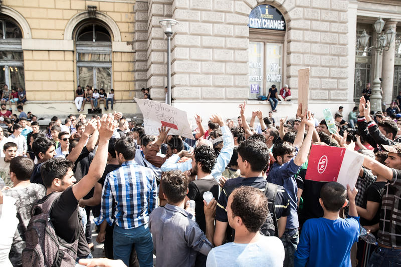 Stranded Refugees protest in front of the Keleti Train station d. BUDAPEST, HUNGARY - SEPTEMBER 01: Stranded Refugees protest and demand free passage to Germany stock photo