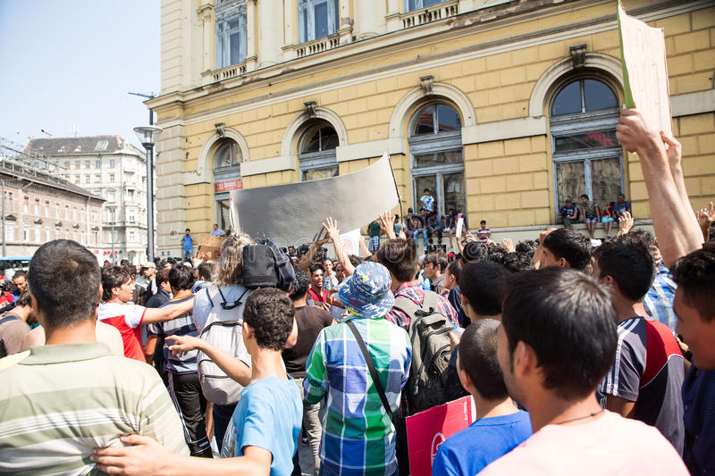 Stranded Refugees protest in front of the Keleti Train station d. BUDAPEST, HUNGARY - SEPTEMBER 01: Stranded Refugees protest and demand free passage to Germany royalty free stock photography