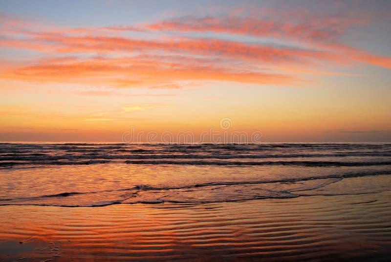 stranden colors soluppgång arkivbild