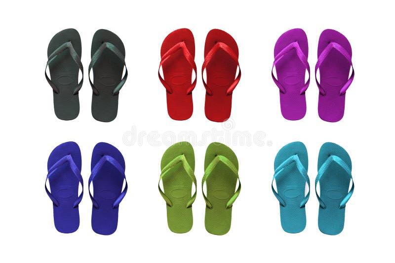 stranden färgade inställda sandals royaltyfri bild