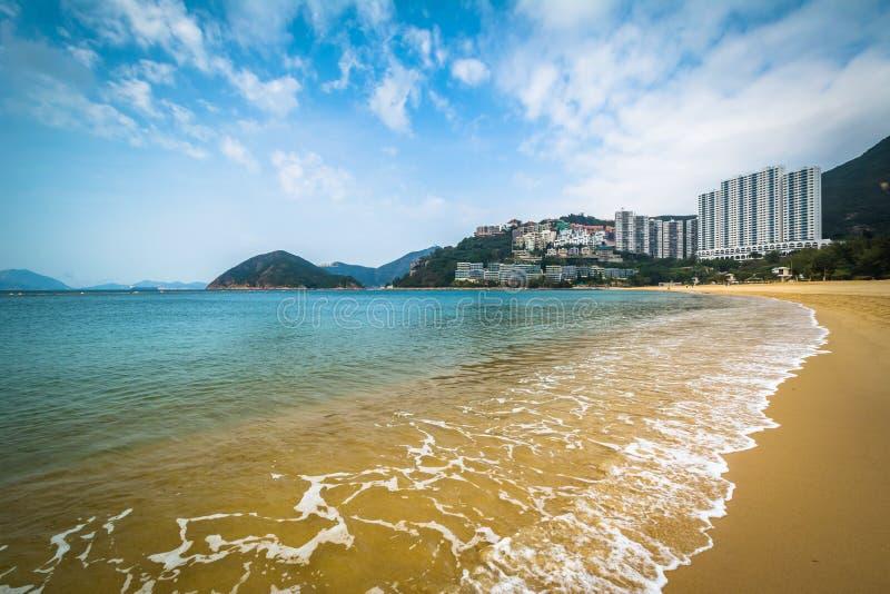 Stranden och skyskrapor på avvvisanden skäller, i Hong Kong, Hong Kong arkivfoton