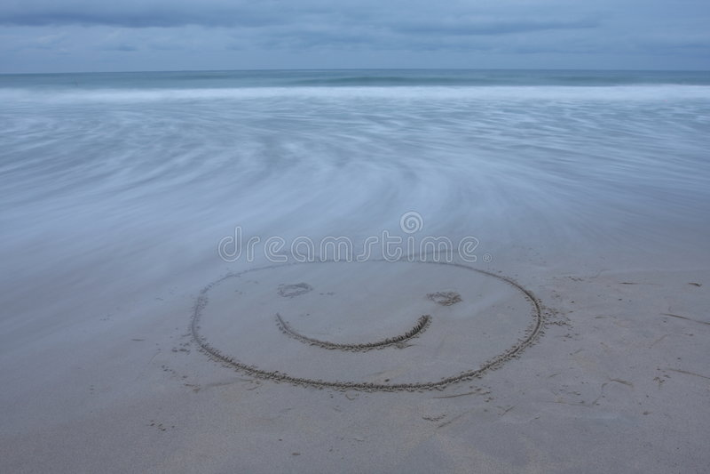 stranden tecknade att le för framsida arkivfoto
